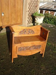 Arts & Crafts carved oak settle with storage