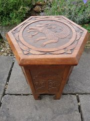 Arts & Crafts carved oak table with storage