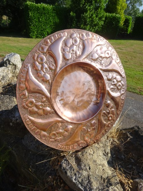 Arts & Crafts copper charger in the Newlyn style