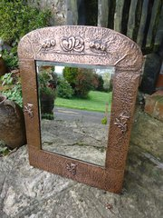 Arts & Crafts copper floral mirror