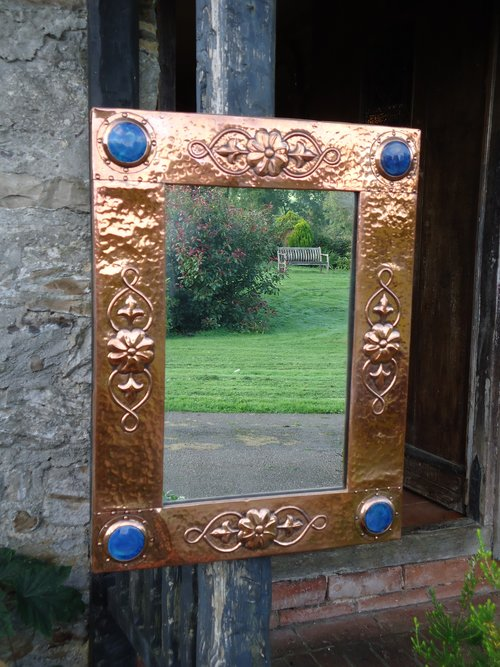 Arts & Crafts copper mirror with cabochons