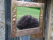 Arts & Crafts copper mirror with motto