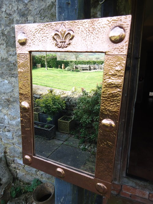 Arts & Crafts copper mirror with Fleur-de-lys