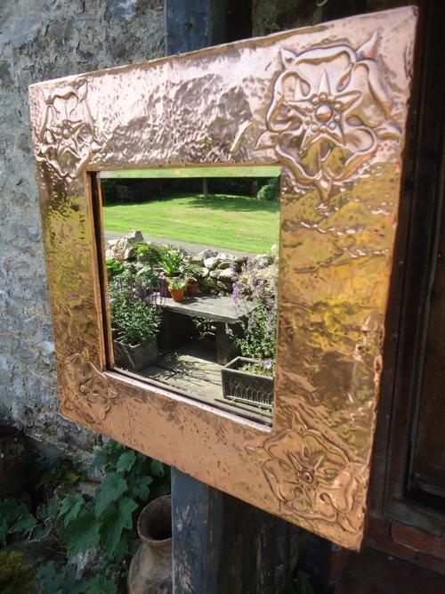 Arts & Crafts copper mirror with Tudor roses