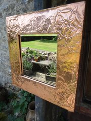 Arts & Crafts copper mirror with Tudor roses