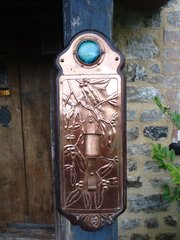 Arts & Crafts copper sconce with Ruskin