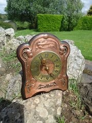 Arts & Crafts copper wall clock with brass face