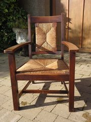 Arts & Crafts oak armchair with rush back and seat