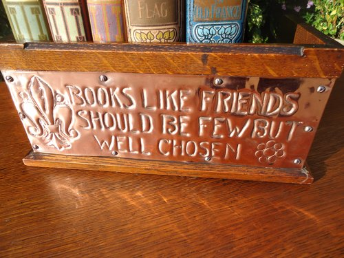 Arts & Crafts oak book stand with motto