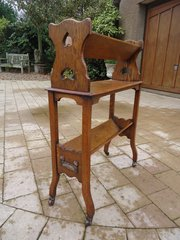 Arts & Crafts oak book stand with hearts