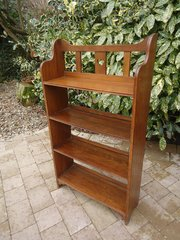 Arts & Crafts oak bookcase with heart to centre