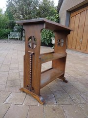 Arts & Crafts oak bookstand with piercings