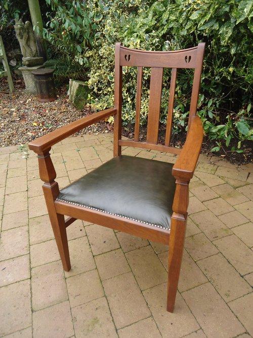 Arts & Crafts oak chair. E.A. Taylor