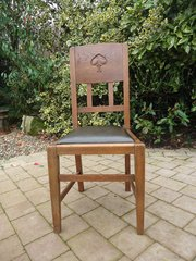 Arts & Crafts oak chair by W.J. Neatby