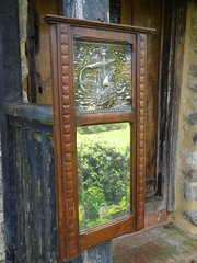 Arts & Crafts oak framed mirror with brass ship