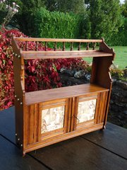 Arts & Crafts oak hanging cabinet with tiles