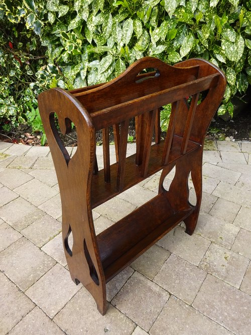 Arts & Crafts oak magazine rack with book trough