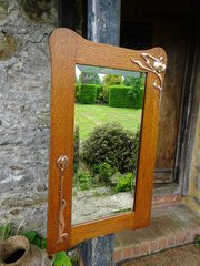 Arts & Crafts oak mirror with copper overlay