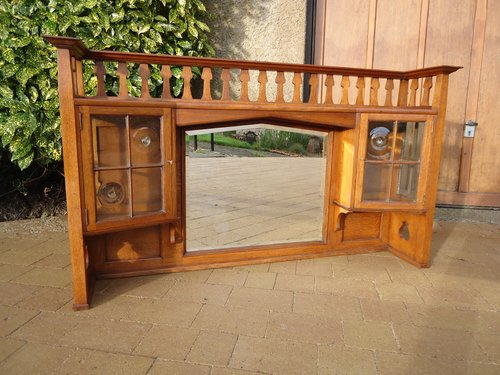Stuning Arts & Crafts oak overmantle with cupboard