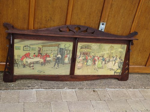 Arts & Crafts oak overmantle with prints