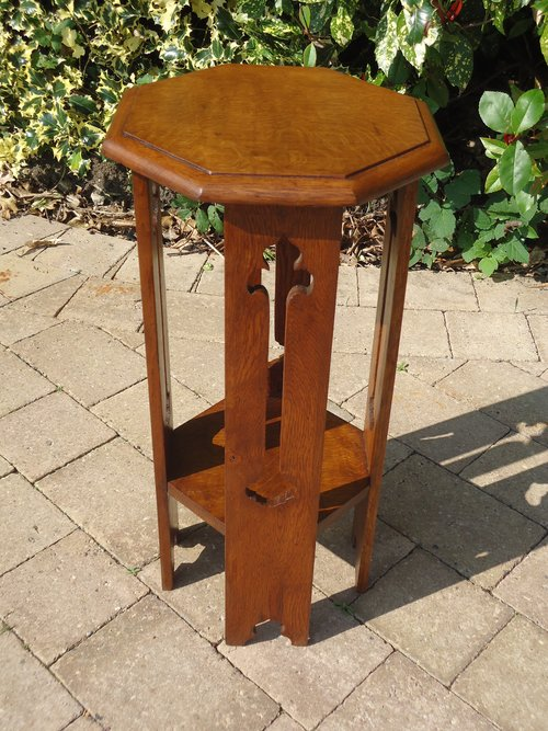 Arts & Crafts oak plant stand with pierced legs