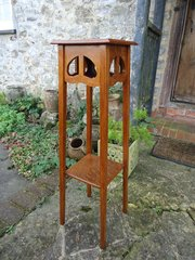 Arts & Crafts oak plant stand with split heart