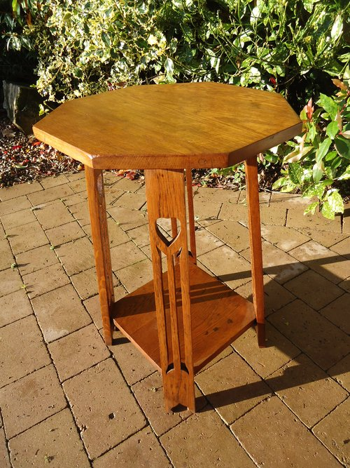 Arts & Crafts oak table with pierced hearts to leg