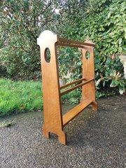 Arts & Crafts oak towel rail.