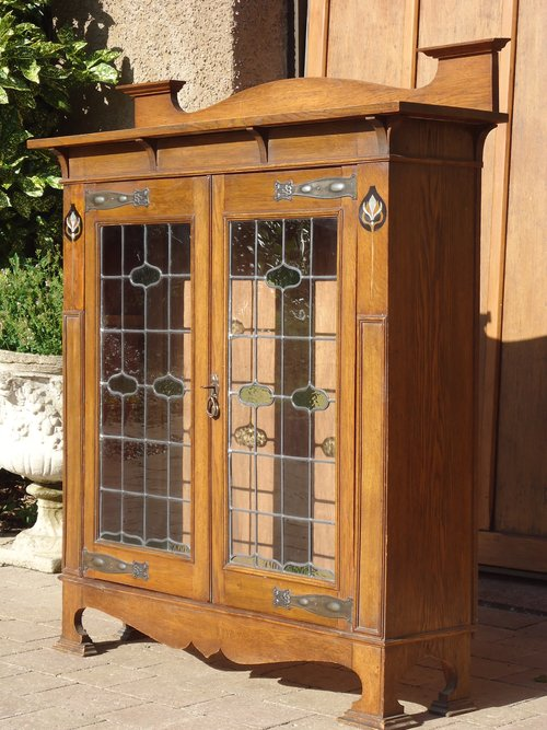 Arts & Crafts oak two door glazed bookcase
