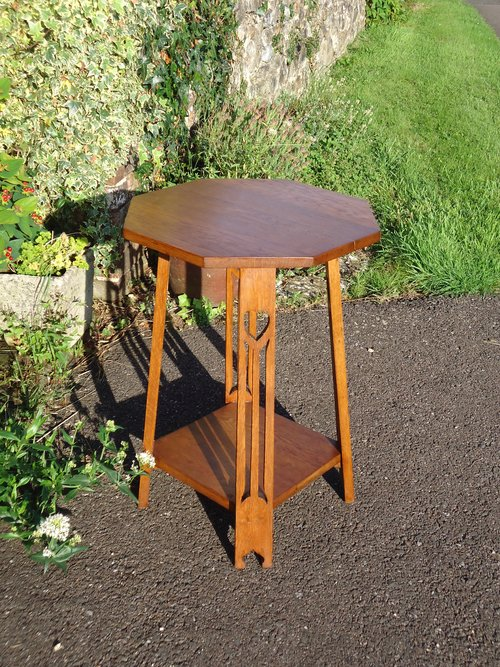 Arts & Crafts octagonal oak table with pierced hearts