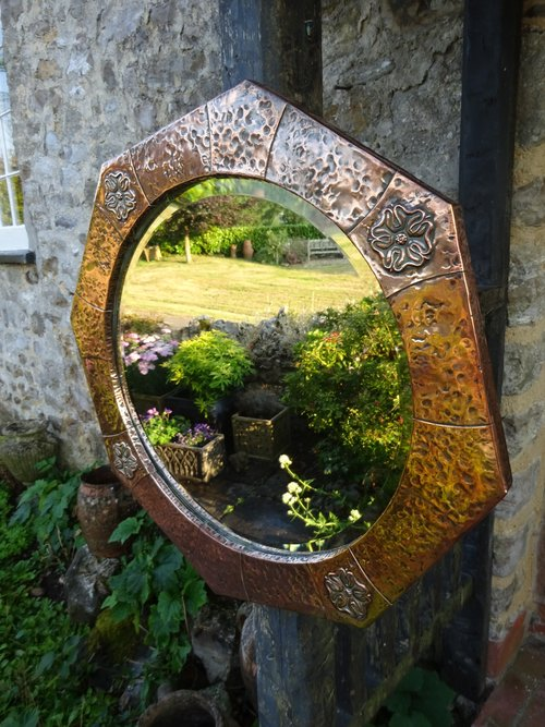 Arts & Crafts octagonal copper  mirror with roses