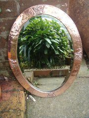 Arts & Crafts oval copper mirror.
