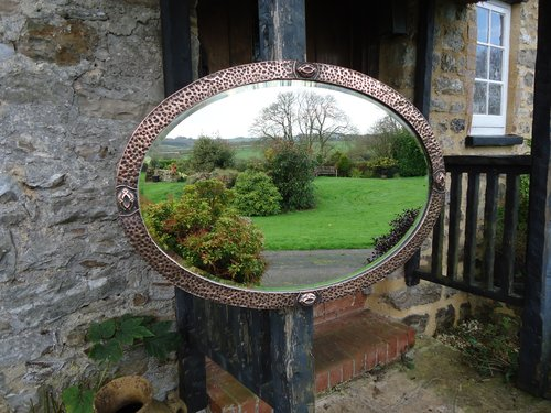 Arts & Crafts oval hammered copper mirror