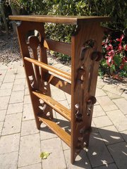 Arts & Crafts pegged book stand with tulips