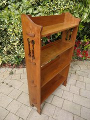 Arts & Crafts pegged oak bookshelves with tulips