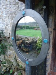 Arts & Crafts pewter mirror with cabochons