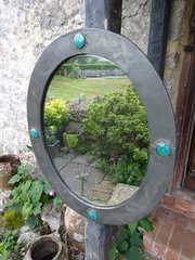Arts & Crafts pewter oval mirror for Liberty