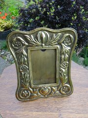 Arts & Crafts photo frame in brass