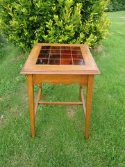 Arts & Crafts tiled top table with maroon tiles