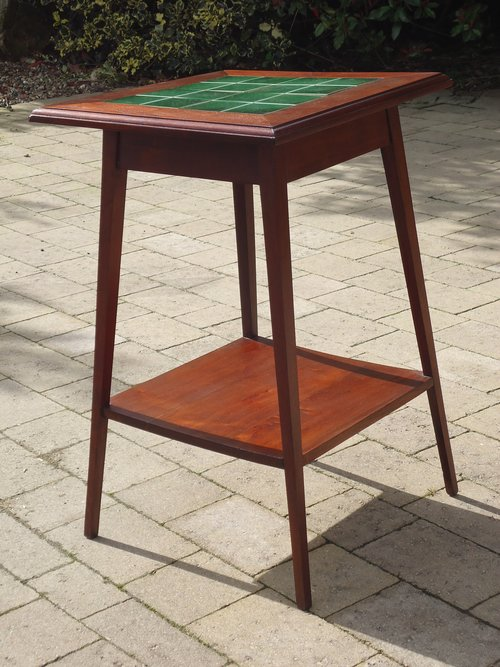 Arts & Crafts tiled top table in walnut