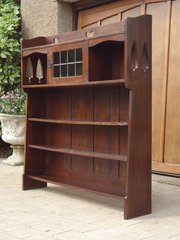 Iconic Liberty bookcase with Voysey style trees