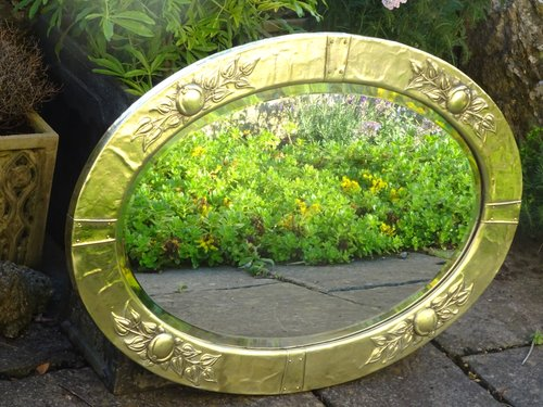 Large Arts & Crafts Oval brass mirror with medlars