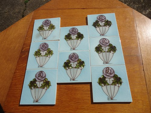 Lovely set of Eight Arts & Crafts tube lined tiles