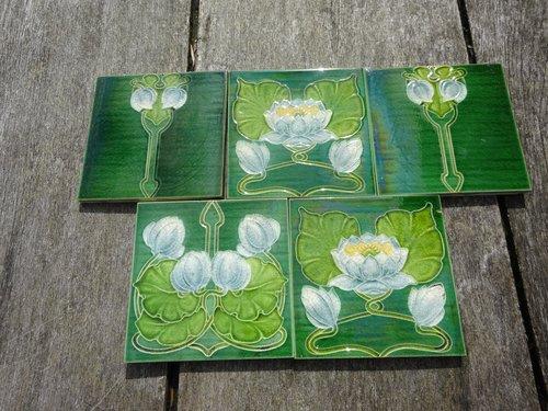 Lovely set of five Arts & Crafts floral tiles
