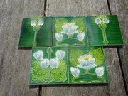 Lovely set of five Arts & Crafts floral tiles