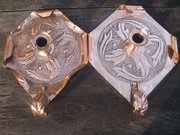 Matched pair Arts & Crafts candleholders.