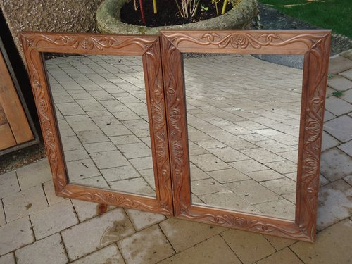 Matched pair of Arts & Crafts carved mirrors