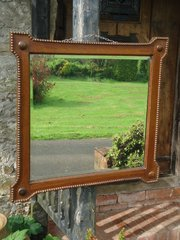 Oak mirror with original bevelled glass