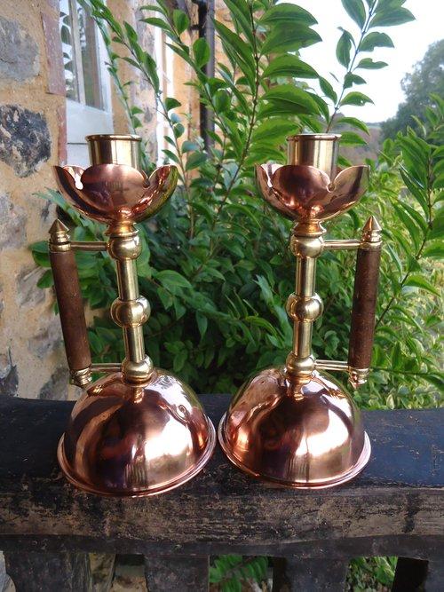 Pair of Arts & Crafts candlestick . Dresser