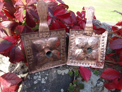 Pair of Arts & Crafts copper candleholders